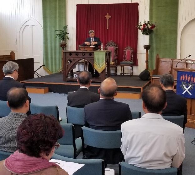 pastor lee preaching.jpg